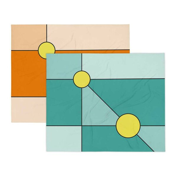 two blankets with a minimalist design of two yellow circles, one on an orange background, the other on a teal blue background