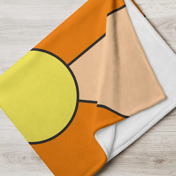 folded blanket with a minimalist design of two yellow circles on an orange background