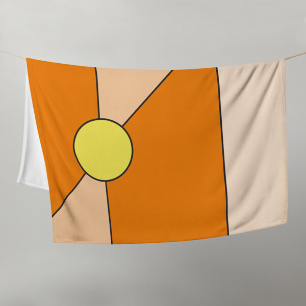 blanket with a minimalist design of two yellow circles on an orange background, hanging on a clothes line