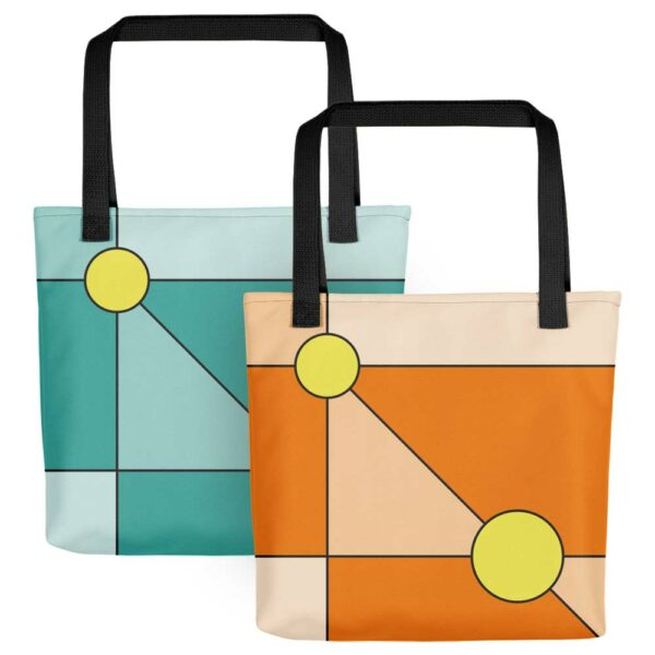 two tote bags with two yellow circles in a minimalist design, one on a teal blue background, one on an orange background, both with black handles
