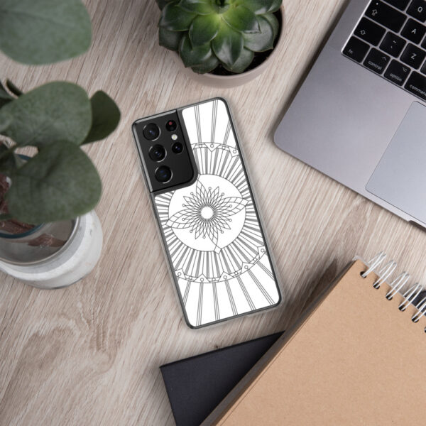 samsung phone case that has a geometric black line drawing on a white background sitting next to a laptop