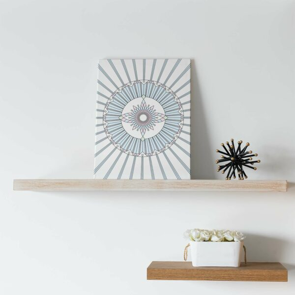 vertical stretched canvas art print with a geometric design in black lines and pastel colors on a white background sitting on a shelf