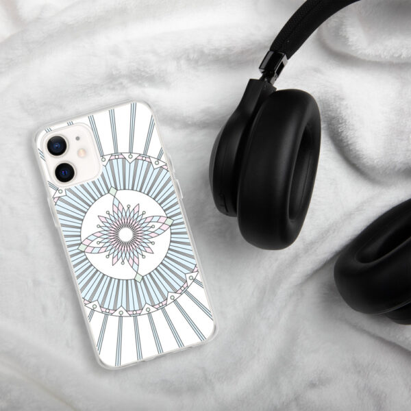 iphone case that has a geometric black line drawing with pastel colors on a white background sitting next to headphones