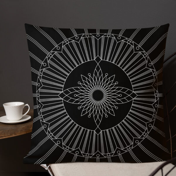 square pillow with a geometric white line drawing on a black background