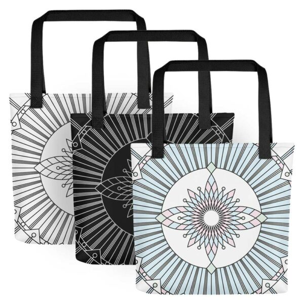 three tote bags with geometric designs, one white bag with black lines, one black bag with white lines, one white bag with black lines and pastel colors