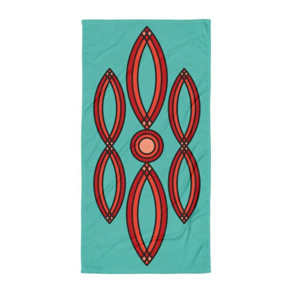 beach towel with a red geometric design on a blue background