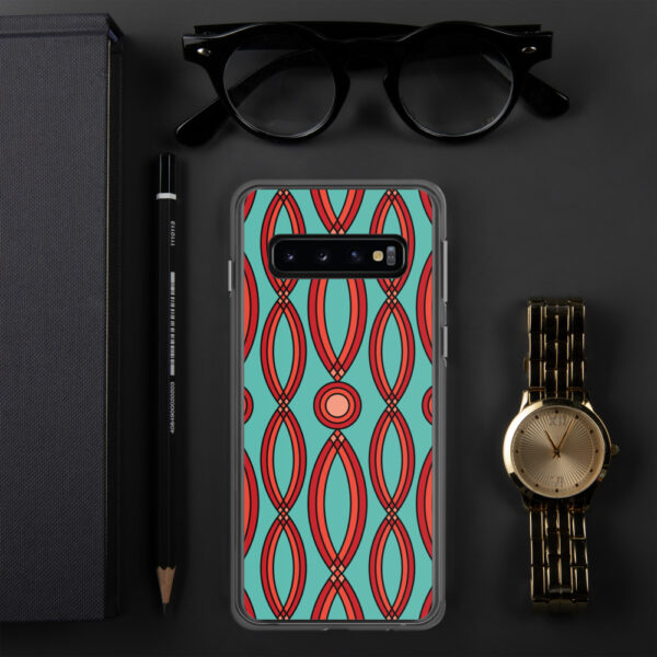 samsung phone case that has a red geometric shape pattern on a teal blue background sitting next to a watch