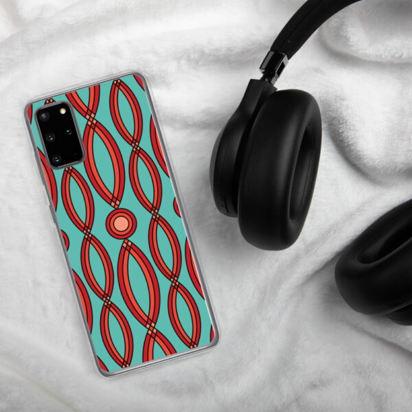 samsung phone case that has a red geometric shape pattern on a teal blue background sitting next to headphones