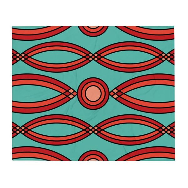 blanket with a red mosaic pattern on a teal blue background