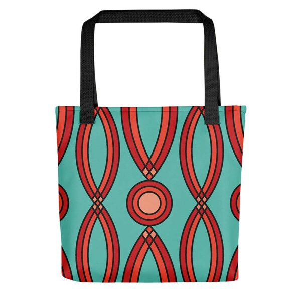 teal blue tote bag with a red geometric design and black handles