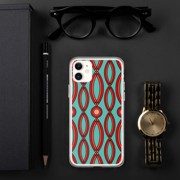 iphone case that has a red geometric shape pattern on a teal blue background sitting next to a watch