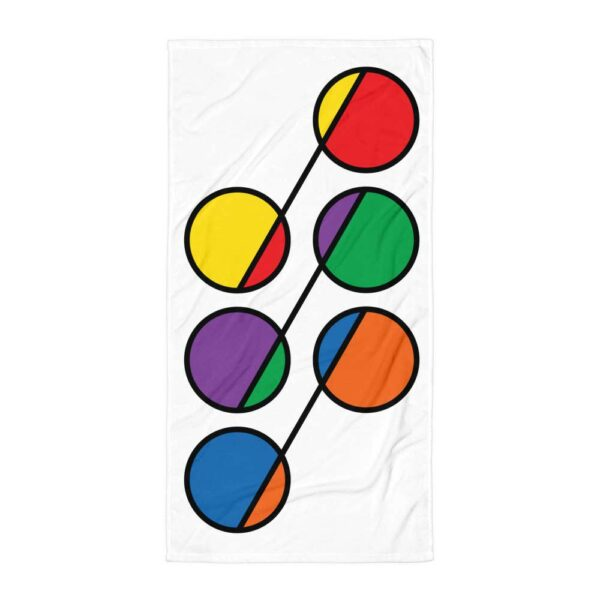white beach towel with a colorful abstract design of six rainbow circles