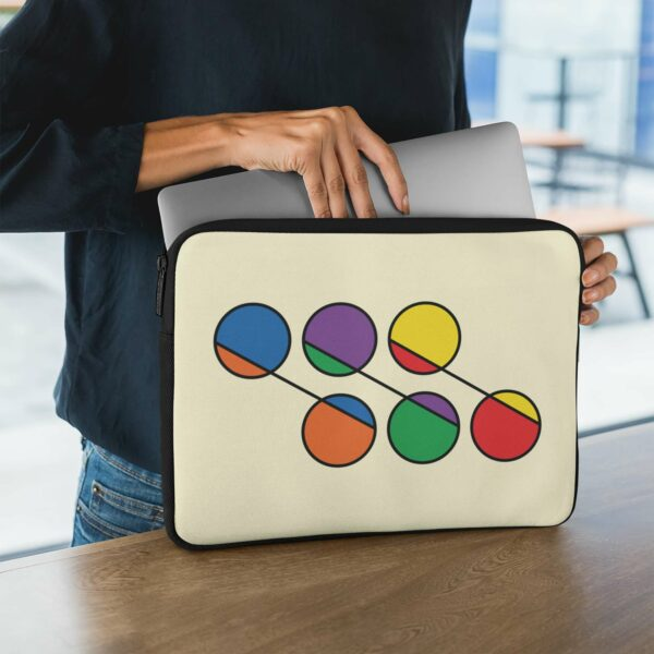 person holding a laptop sleeve with six circles in rainbow colors on a yellow background