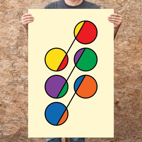 person holding a large vertical fine art print with a colorful design of six circles in rainbow colors