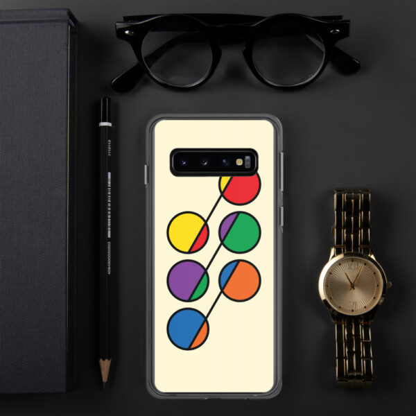 samsung phone case that has six colorful circles in rainbow colors on a yellow background sitting next to a watch