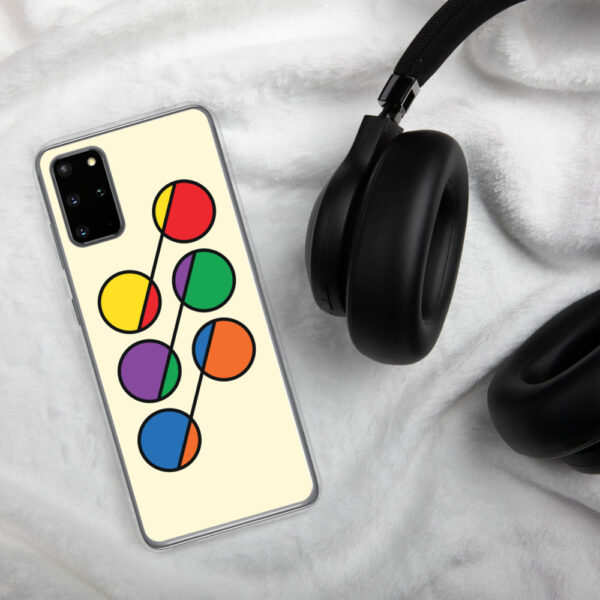 samsung phone case that has six colorful circles in rainbow colors on a yellow background sitting next to headphones