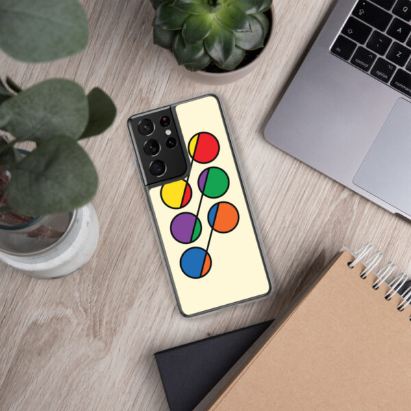 samsung phone case that has six colorful circles in rainbow colors on a yellow background sitting next to a laptop