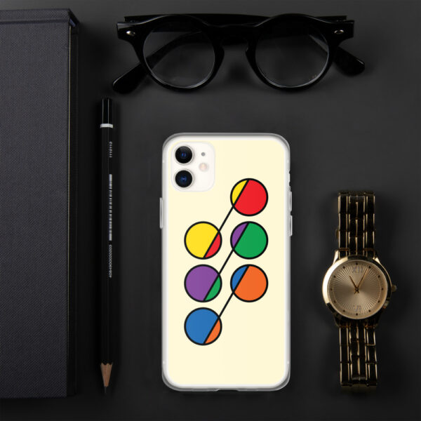 iphone case that has six colorful circles in rainbow colors on a yellow background sitting next to a watch
