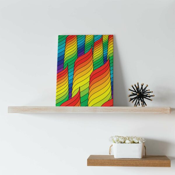 vertical stretched canvas print with an abstract rainbow design sitting on a shelf
