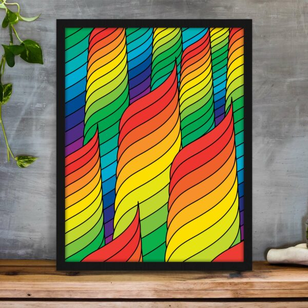 vertical fine art print with an abstract design of rainbow spirals in a black frame on a table