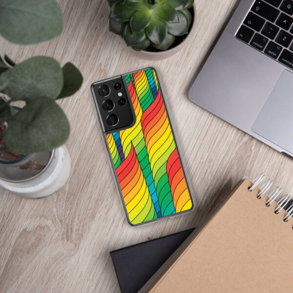 samsung phone case with an abstract design of rainbow spirals sitting next to a laptop
