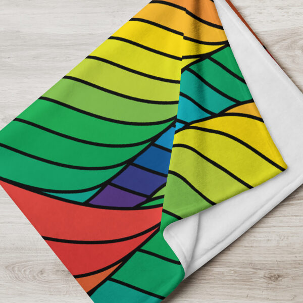 folded blanket with an abstract design of spirals in rainbow colors