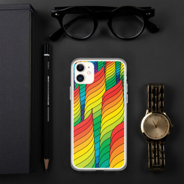iphone case with an abstract design of rainbow spirals sitting next to a watch