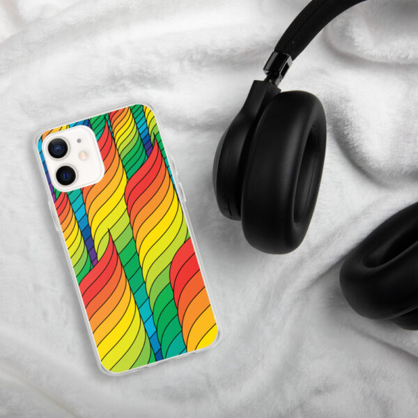 iphone case with an abstract design of rainbow spirals sitting next to headphones