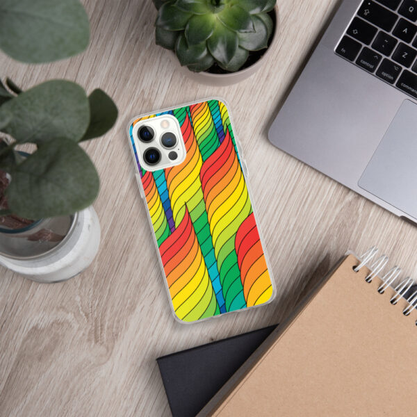iphone case with an abstract design of rainbow spirals sitting next to a laptop