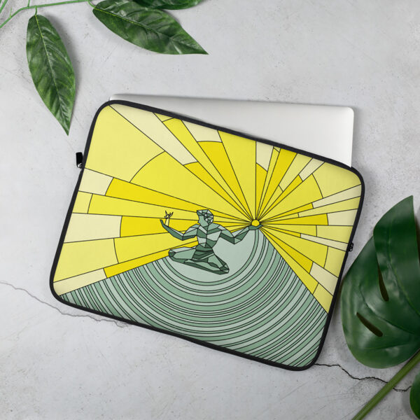 laptop sleeve with a yellow and green illustration of the spirit of detroit sitting on a table