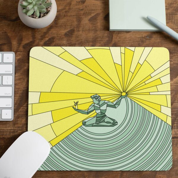 mouse pad with a yellow and green illustration of the spirit of detroit on a desk with a notepad