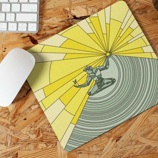 mouse pad with a yellow and green illustration of the spirit of detroit on a desk with a computer mouse