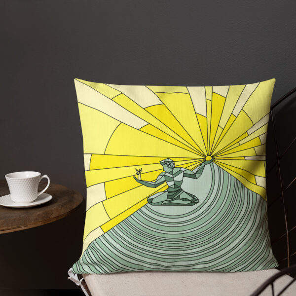 square pillow with a yellow and green illustration of the spirit of detroit sitting on a chair next to a cup of coffee