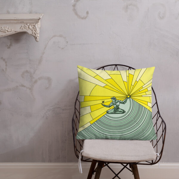 square pillow with a yellow and green illustration of the spirit of detroit sitting on a chair