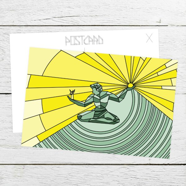 postcard with a yellow and green spirit of detroit design sitting on a table