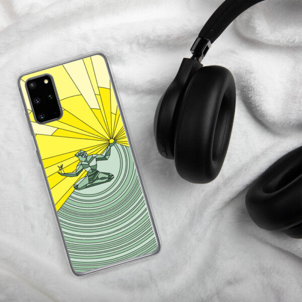 samsung phone case with a yellow and green illustration of the spirit of detroit design sitting next to headphones