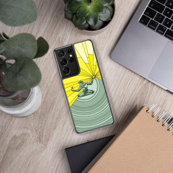 samsung phone case with a yellow and green illustration of the spirit of detroit design sitting next to a laptop