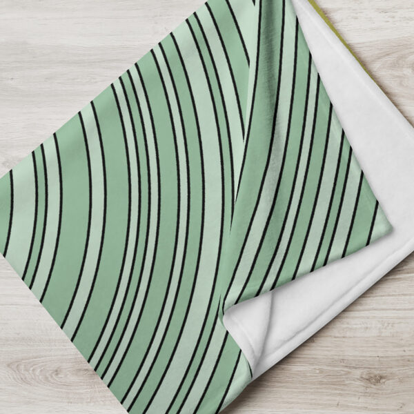 folded blanket with a yellow and green spirit of detroit design
