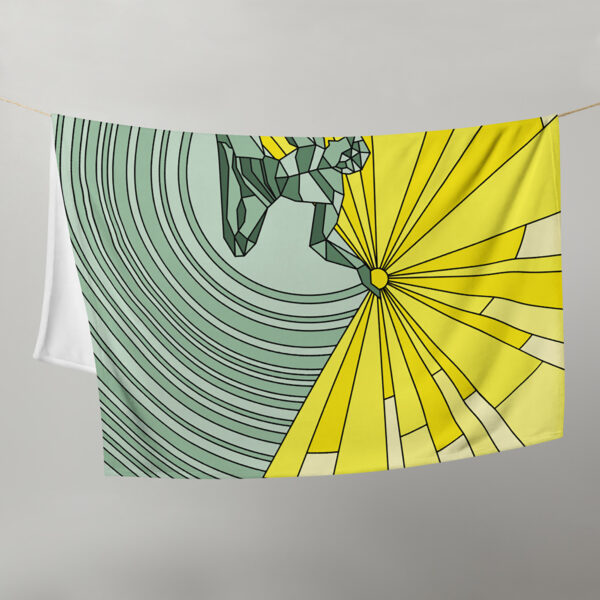 blanket with a yellow and green spirit of detroit design, hanging on a clothes line