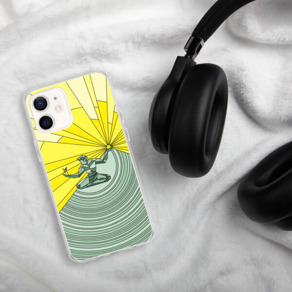 iphone case with a yellow and green illustration of the spirit of detroit design sitting next to headphones