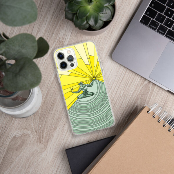 iphone case with a yellow and green illustration of the spirit of detroit design sitting next to a laptop