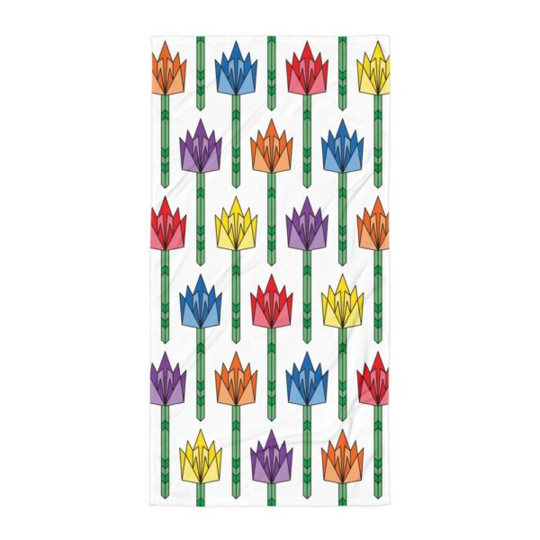 white beach towel with a pattern of colorful tulips in rainbow colors