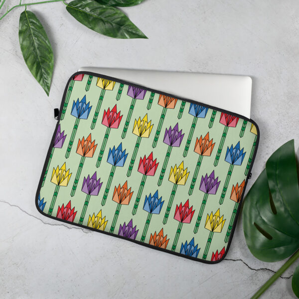 laptop sleeve with a pattern of tulip flowers in a mid-century design with rainbow colors sitting on a table