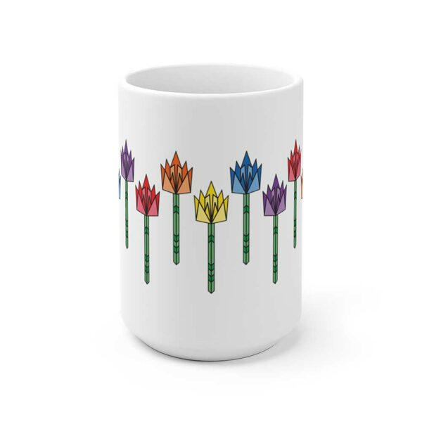 side view of a white ceramic coffee mug with tulip flowers in rainbow colors around the sides