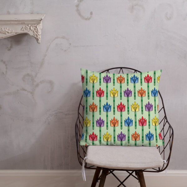 square pillow with a pattern of tulip flowers in rainbow colors and a mid-century style sitting on a chair