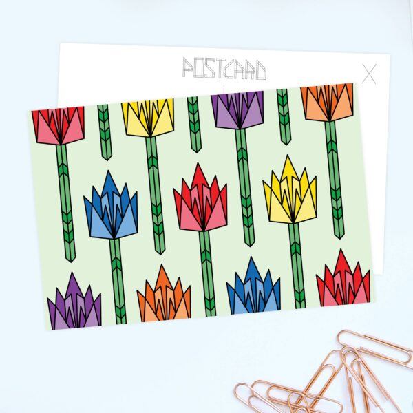 postcard with a design of tulips in rainbow colors sitting on a table