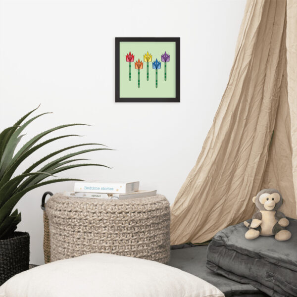 square fine art print of five colorful tulips on a light green background in a black frame hanging on a wall
