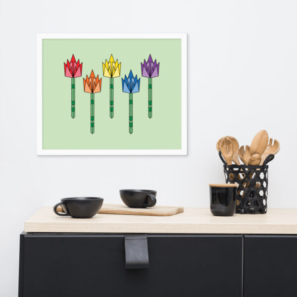 horizontal fine art print of five colorful tulips on a light green background in a white frame hanging on a wall