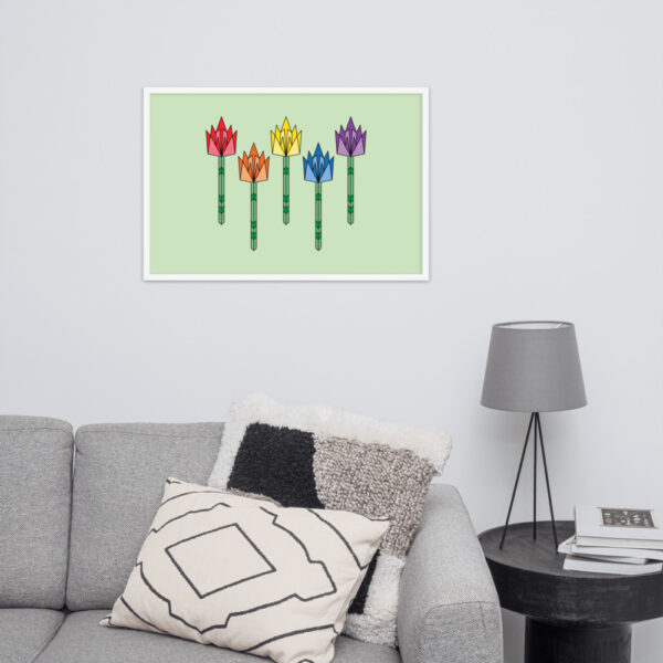 horizontal fine art print of five colorful tulips on a light green background in a white frame on a wall above a sofa