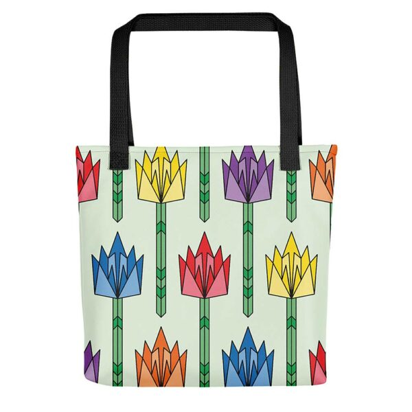 light green tote bag with black handles and a pattern of tulip flowers in rainbow colors